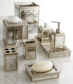 Beautifully coordinated set of bath accessories. The mirrored panels and  vintage look make for the