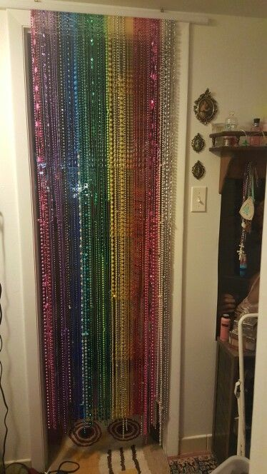 Mardi gras beads into a beaded door curtain.