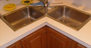 Give luxurious designs to modular kitchen with corner kitchen sink cabinet