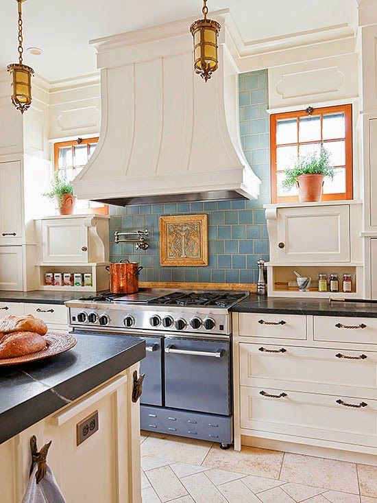 Here is another kitchen backsplash idea from French Country Cottage with  blue tile & white cupboards.