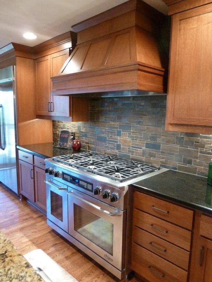stone backsplash @Kitchens by Design Omaha