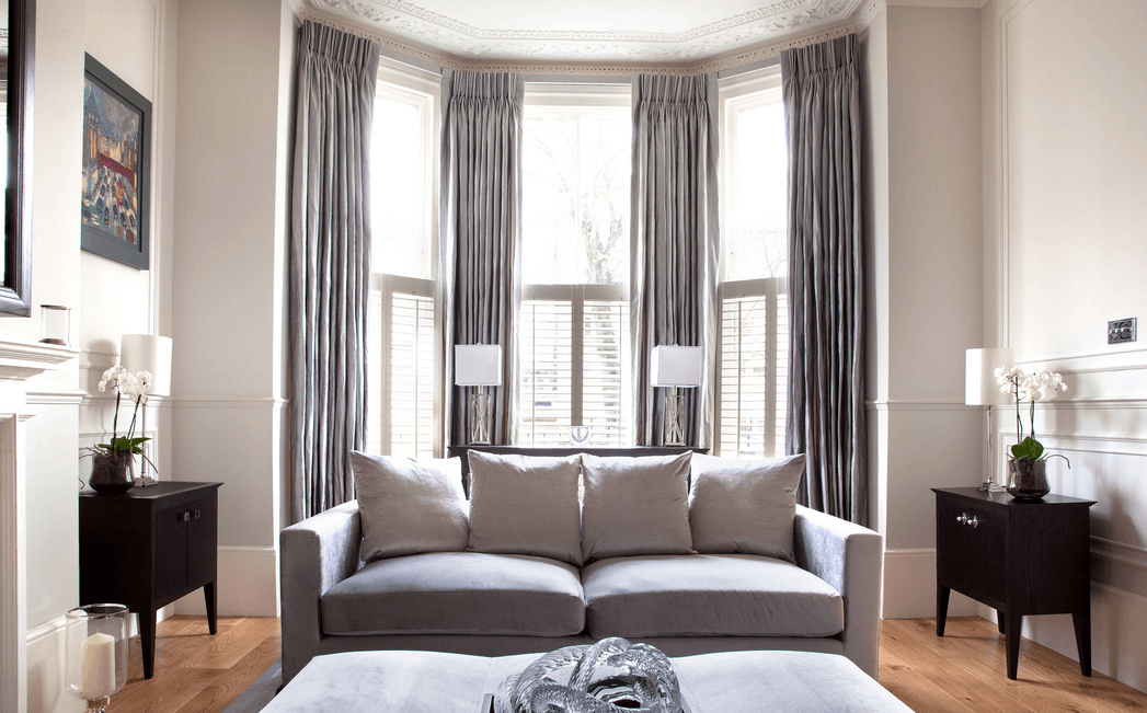 bay windows and grey curtains. Source. swing arm living room curtains