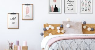 photos hang above bed
