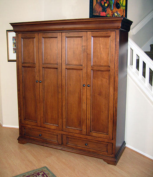 Hide your flat panel TV behind bi-fold pocket doors in the Tuscany Armoire