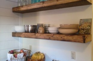 $20 DIY Floating Shelves - After taking down a bay of cabinets in my kitchen  and looking at a bare wall for about a month, I had to make a decision on
