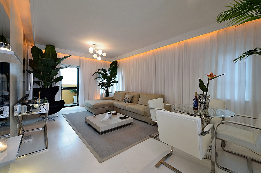 View in gallery Goregous living room in white with orange LED lighting and  a tropical touch