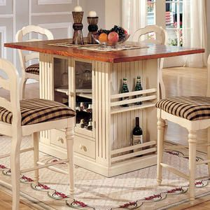 A storage kitchen island and dining table in one with a beautiful white  painted finish! Make this from an old cabinet and use as dining table in  kitchen?