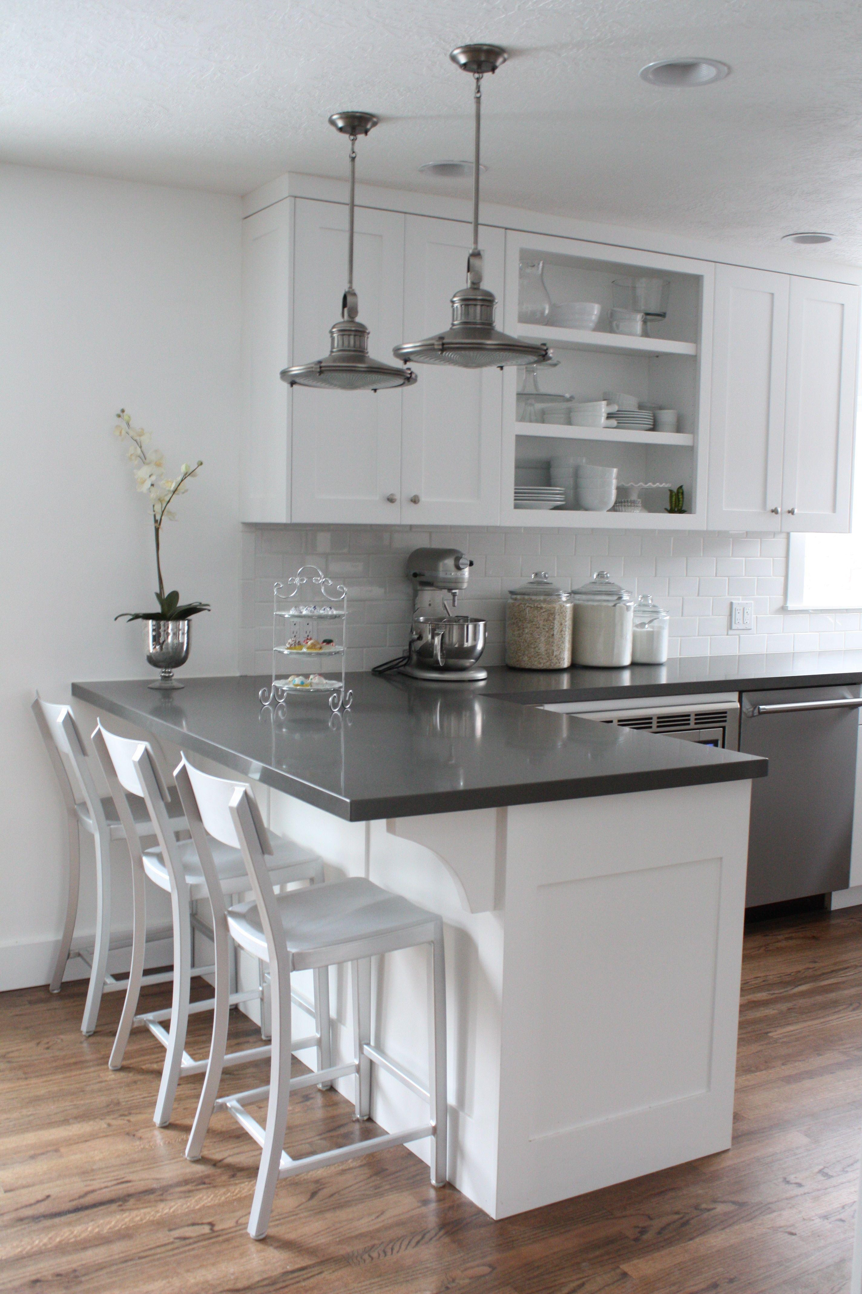 White cabinets, subway tile, quartz countertops