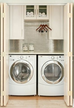 Side by side laundry closet with hanging rod and cabinets | Laundry