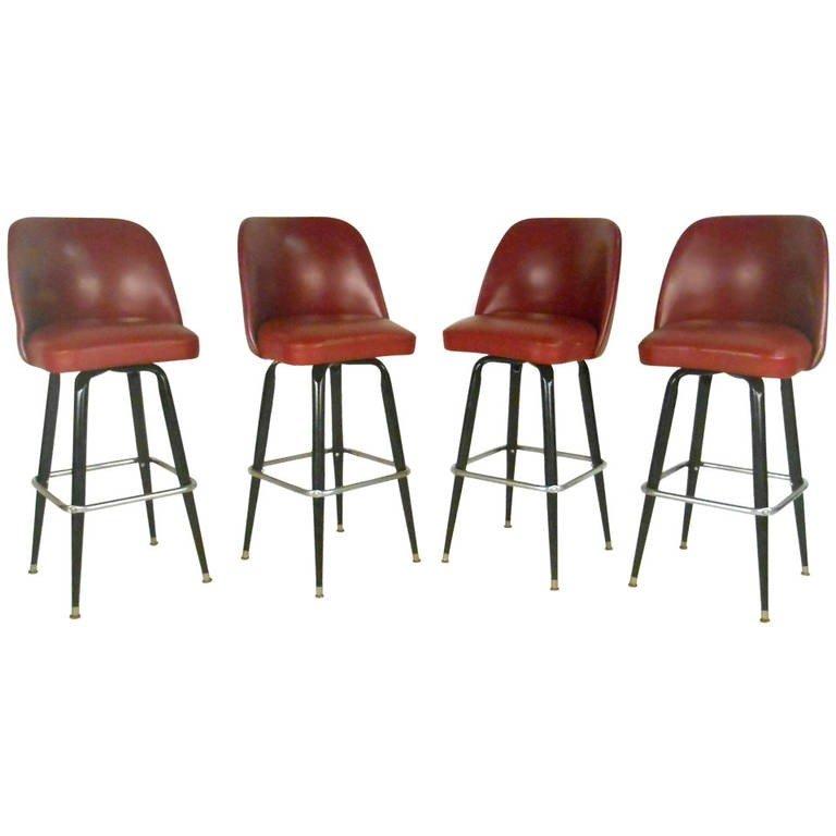 Italian designer bar stools. Set of Four Mid-Century Swivel