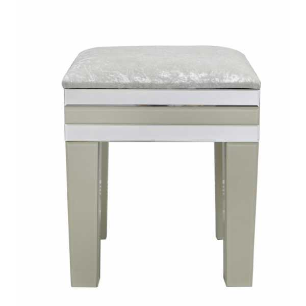 The role of a mirrored glass dressing   table stool