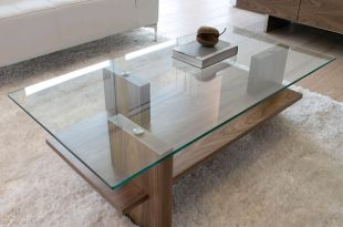 A great example of a modern glass/wood coffee table. The design is  streamlined, allowing the quality of the materials used to shine through.