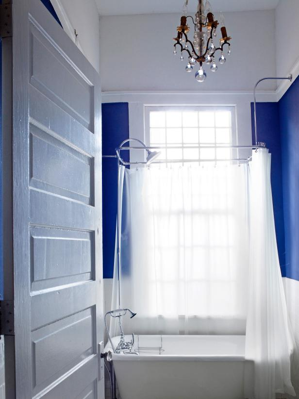 Royal Blue Bathroom With White Slipper Tub