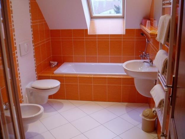A tall bathroom cabinet used as a room divider, modern bathroom design