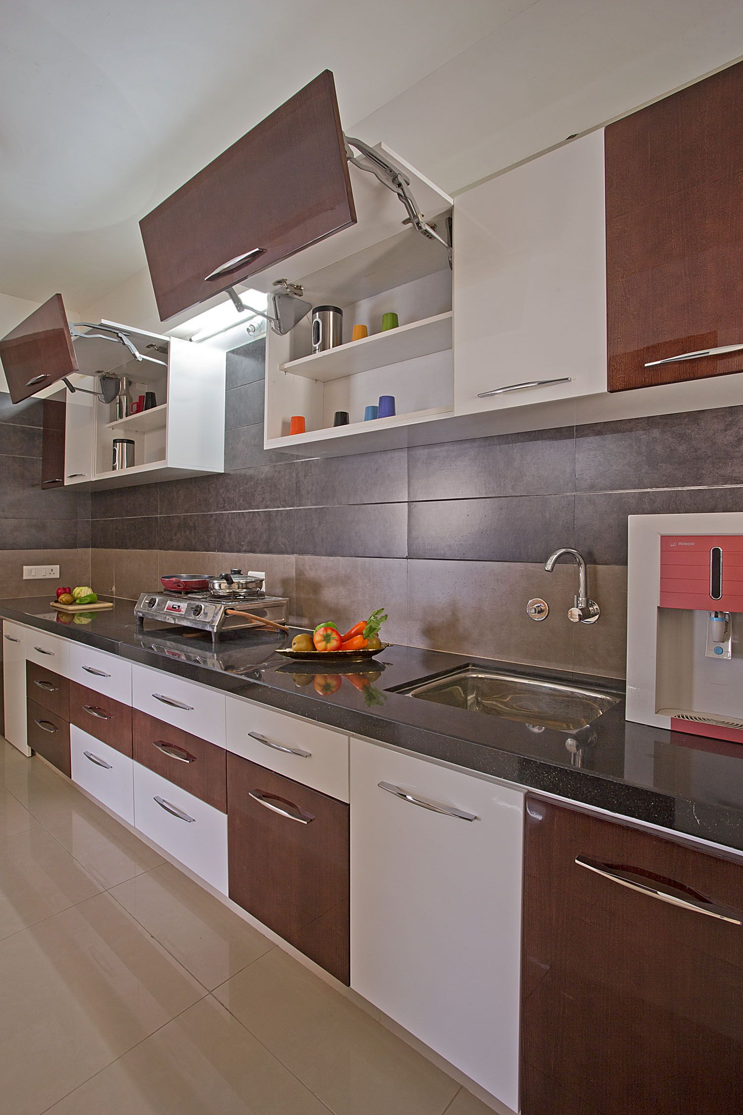 The most asked need for modular kitchen designs is space. In small space,  we have to come up with spacious ideas, which we call storage.