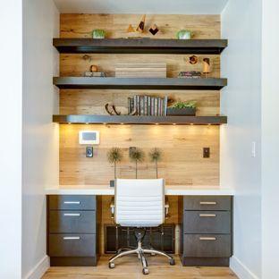 Small trendy built-in desk medium tone wood floor study room photo in Salt  Lake