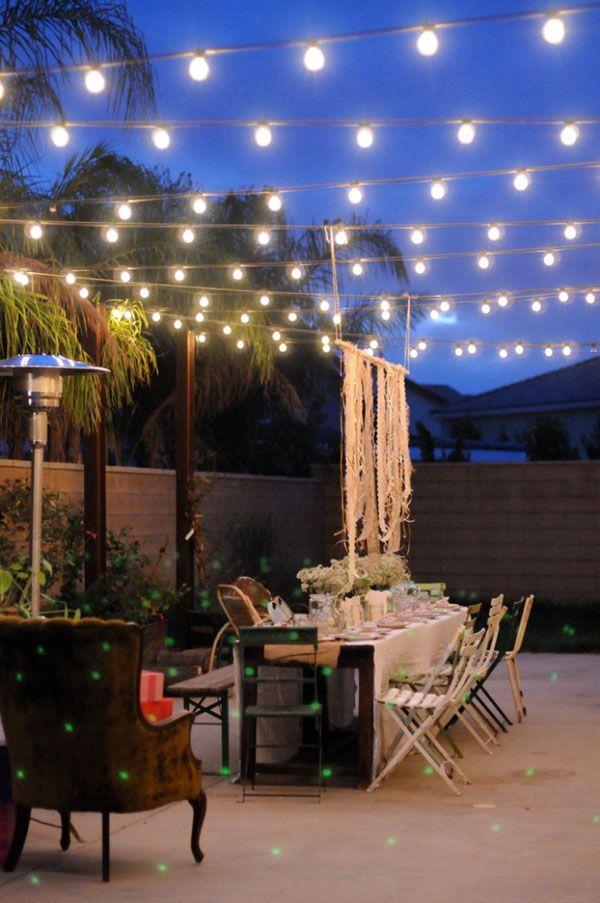 Festoon lights strung across a yard |52 Spectacular outdoor string lights  to illuminate your patio