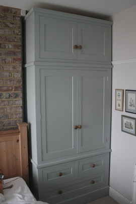 Traditional shaker style painted wardrobes built to fit snuggly in an  alcove of a period style house.