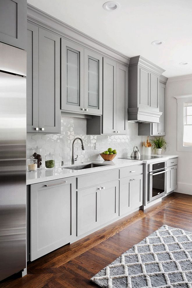 Backsplash Light grey Shaker style kitchen cabinet painted in Benjamin  Moore 1475 Graystone. The walls are Benjamin Moore Dove Wing.