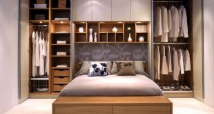 Bedroom Storage Ideas - wardrobes on either side of the bed, and with long  white curtains covering