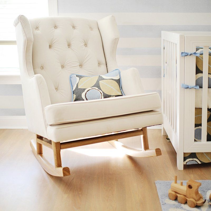 The Nursery Works Empire Rocker has an oversized tufted wing-back frame,  finely upholstered in a durable blend of polyester, linen and viscose.