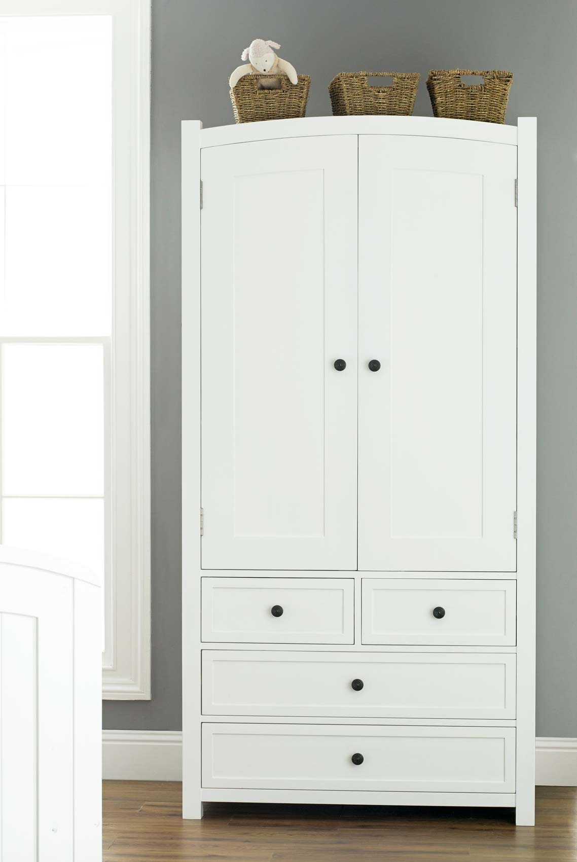 Get bold – a white wooden wardrobe with   drawers for your room