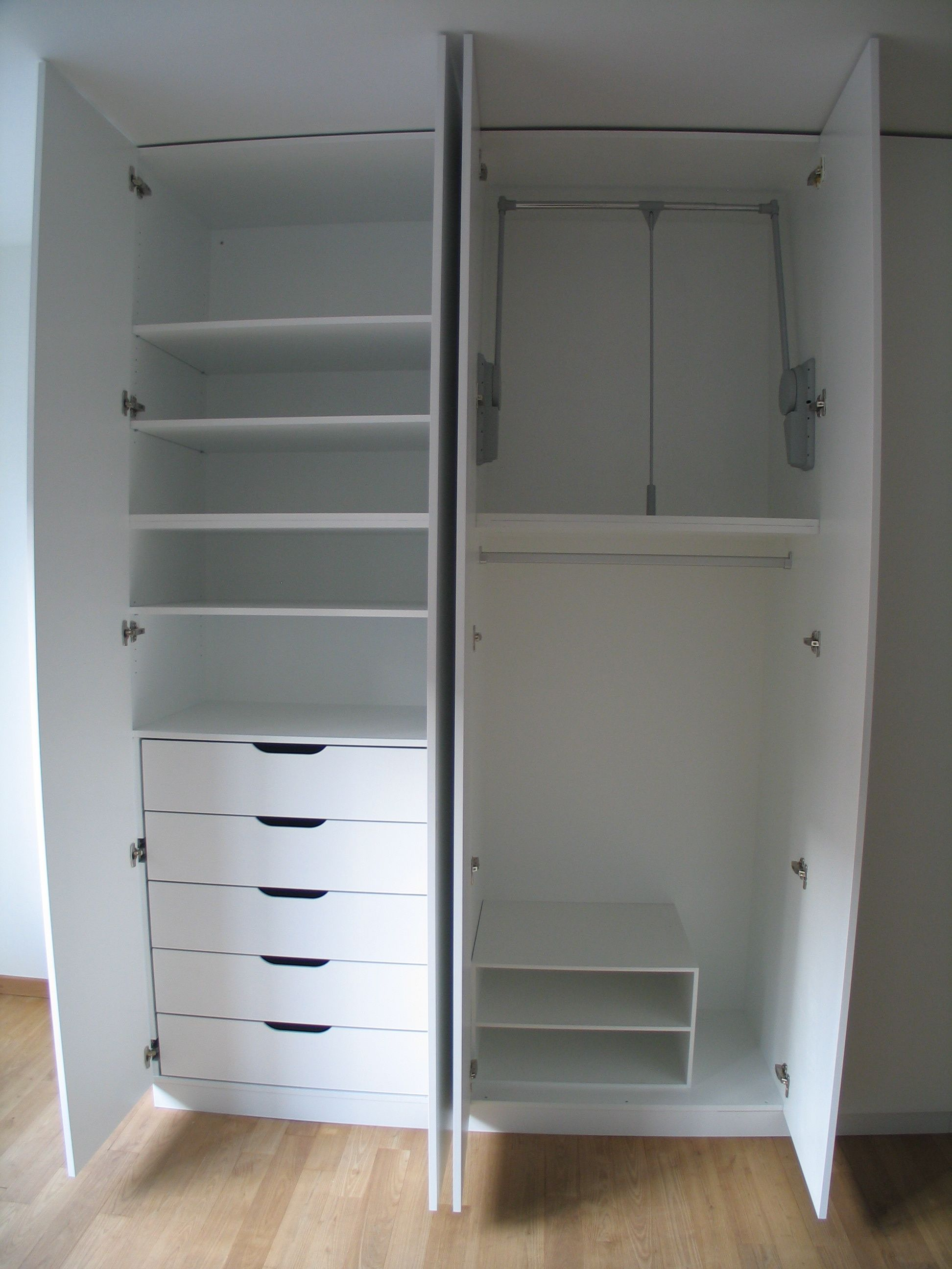 Furniture. white wooden wardrobe five drawers and racks also racks plus  four doors. Amazing